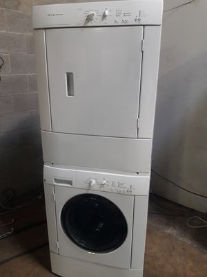 Frigidaire stackable washer and dryer nice condition working perfectly clean and neat warranty and deliver for Sale in Baltimore, MD