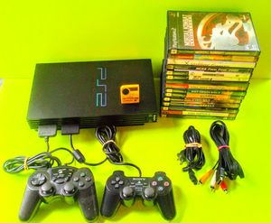 Photo PlayStation 2 with everything including 15 games and 2 controllers complete
