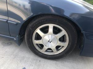 Photo Honda Rims 15x7.5 with brand new tires