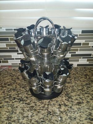 Photo Spinning spice rack with 20 glass jars.