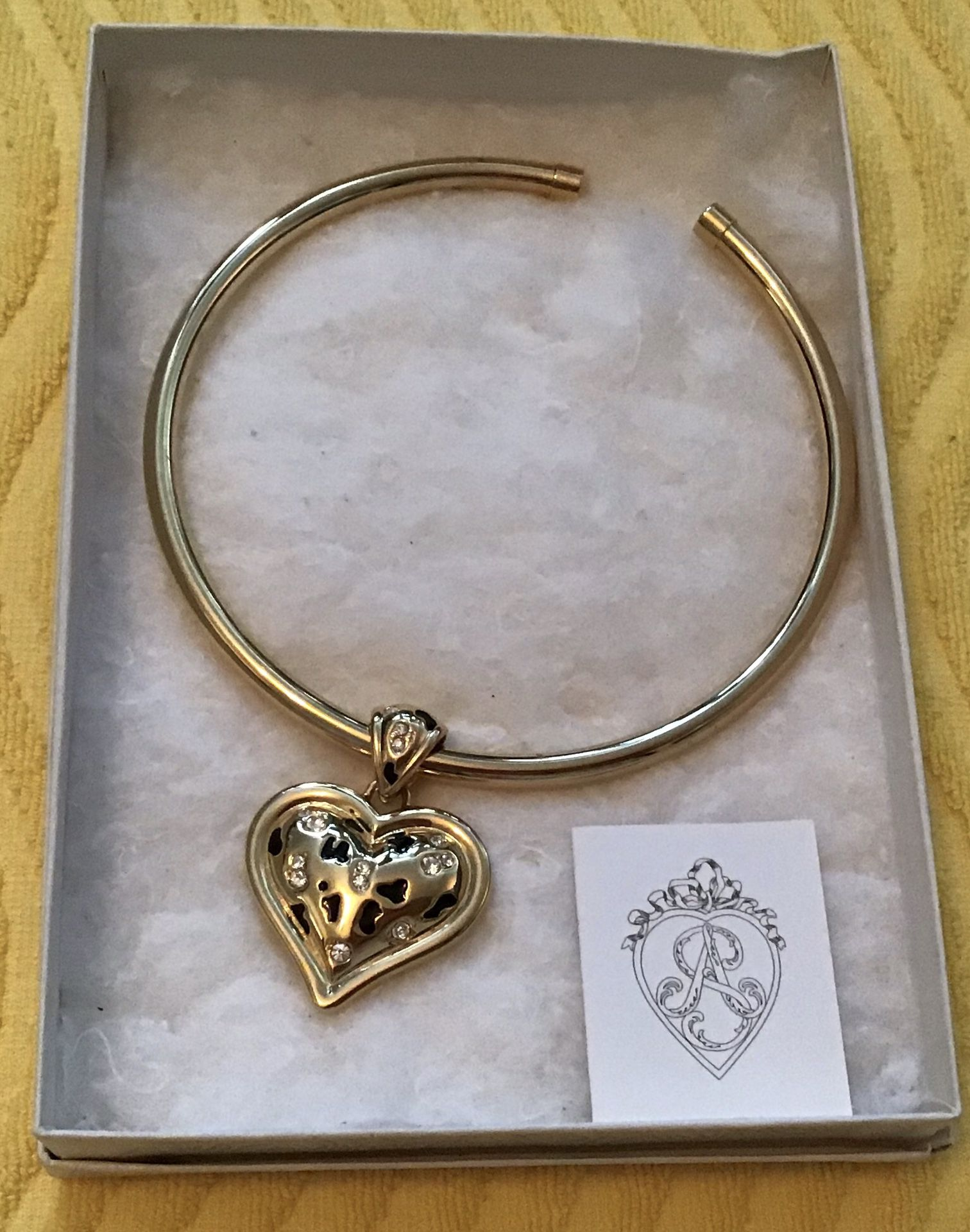 Gorgeous necklace. Double sided heart. This would make a lovely gift. Brand new. Never worn