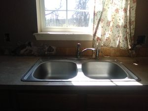 Photo Brand New Stainless steel double pan kitchen sink asking $50 obo...