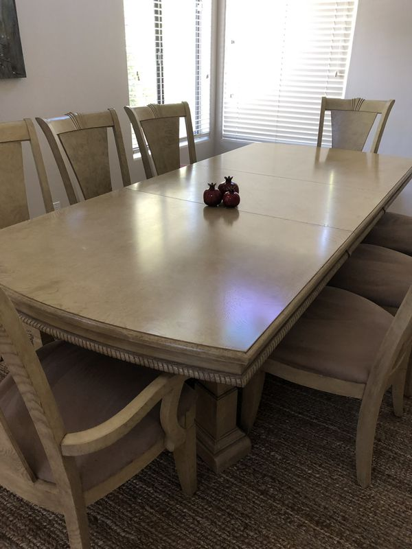 Solid wood dining table and 6 chairs and 2 captain chairs ...