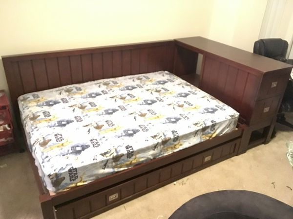 Pottery Barn Kids Riley boys bed with hidden trundle, drawers, and shelves  for Sale in San Jose, CA - OfferUp