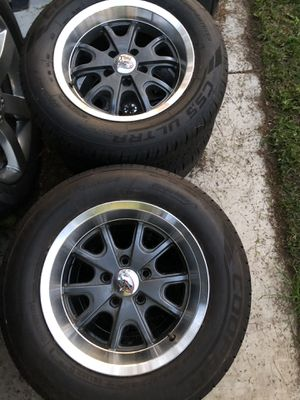 Photo Mustang Rims & Cooper tires 225 /60 /15 bolt pattern 5x4.5 Ford Mustang