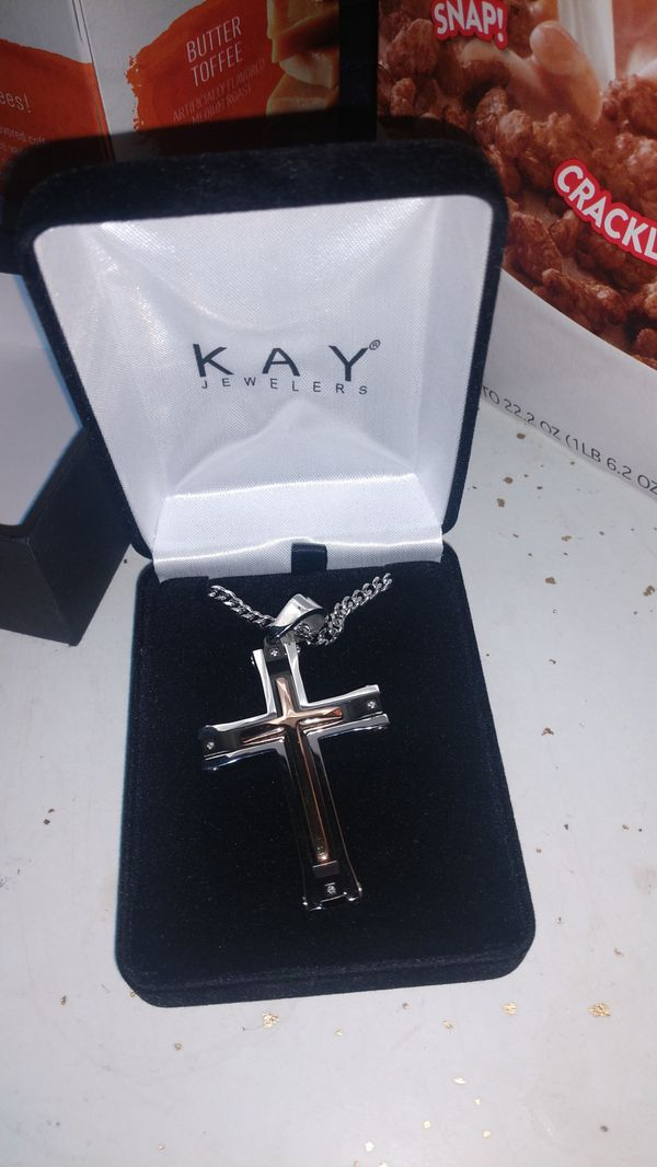 Gold cross with silver chain from kay Jewelers. Joliet, IL