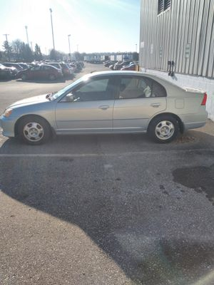Photo For sale 2003 Honda Civic hybrid clean title runs good stick shift 5 speed ready to go good on gas 4 cylinder is my daily drive to work everyday