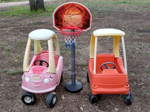 Photo Toy cars and toddler basketball goal