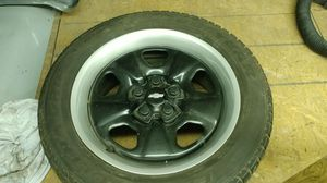 Chevy 5 lug wheels with good tires for Sale in Ashley, OH