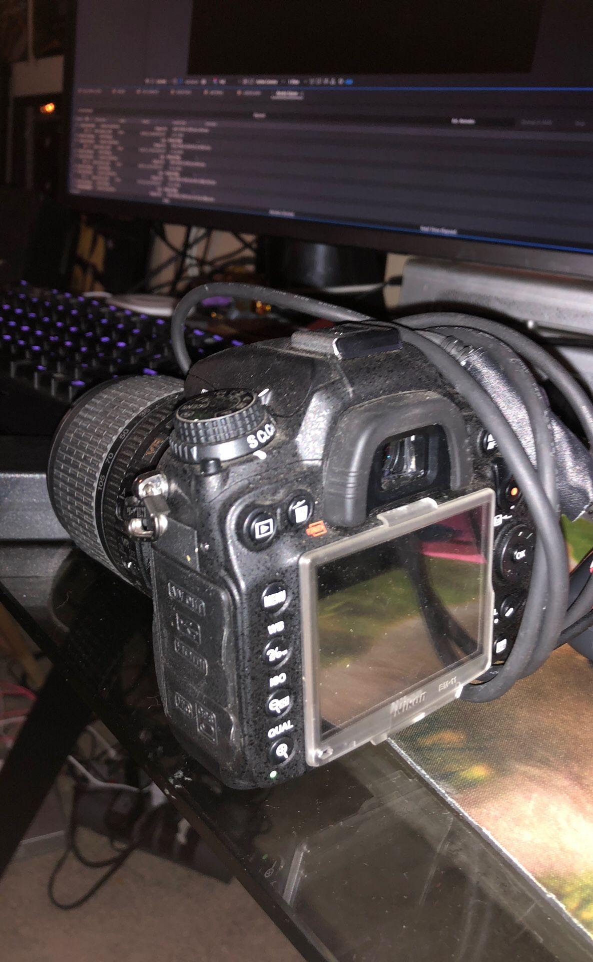 Nikon D7000 w AF-S 18-105mm Lens & Battery Wall Plug