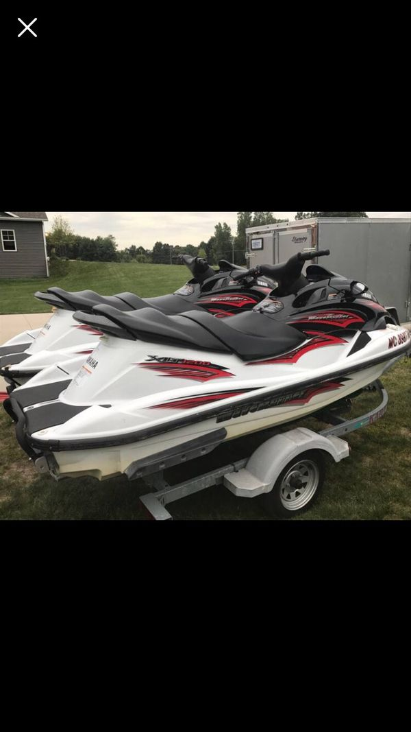 2 wave runners with trailer