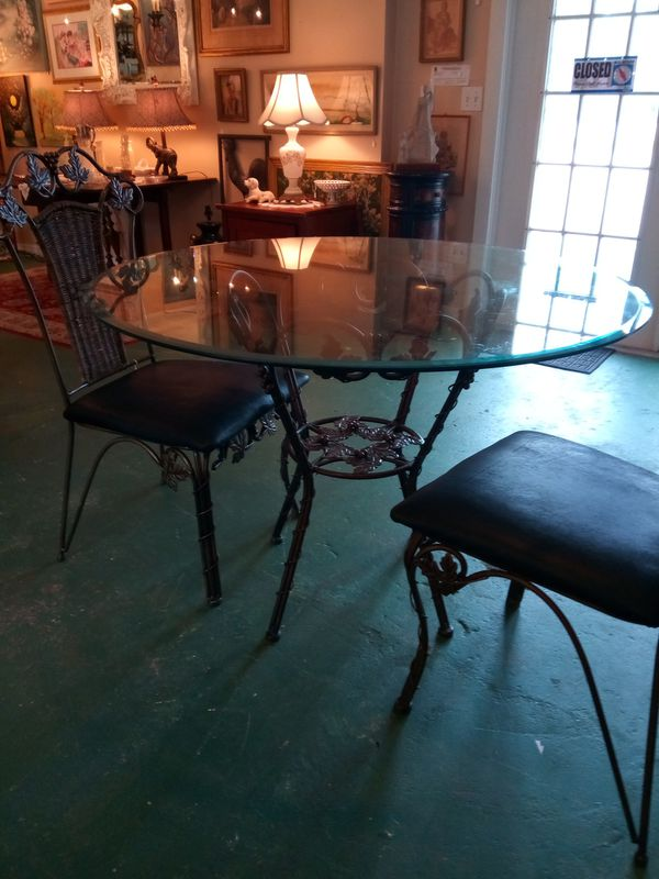 Large Wrought Iron Table With Two Chairs