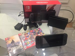 Nintendo Switch including Zelda, Mario Kart Deluxe 8, Super Mario Odyssey, plus memory card for Sale in Washington, DC