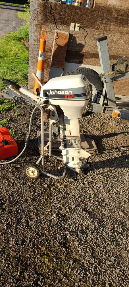 Photo Johnson 15 HP Outboard Motor Stand Not Included