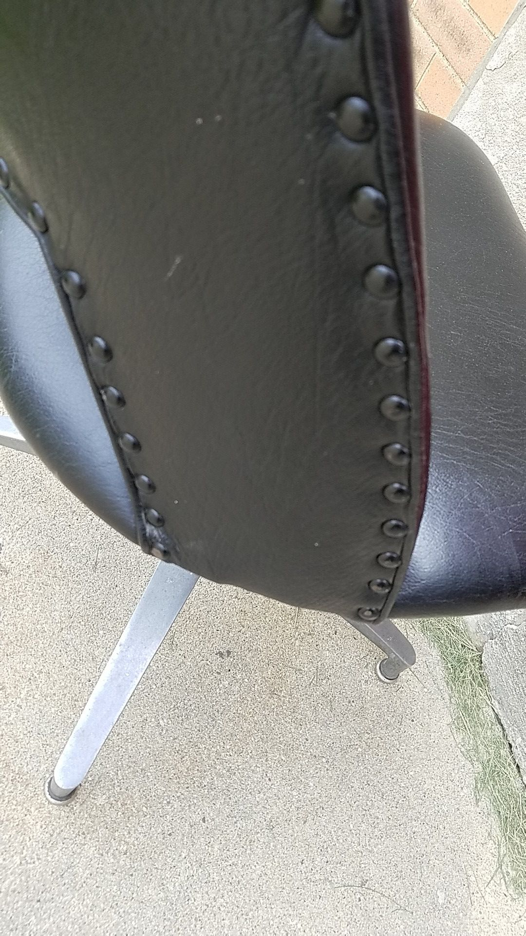 MCM black studded vinyl swivel chair
