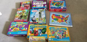 Box of puzzle and games for Sale in Woburn, MA