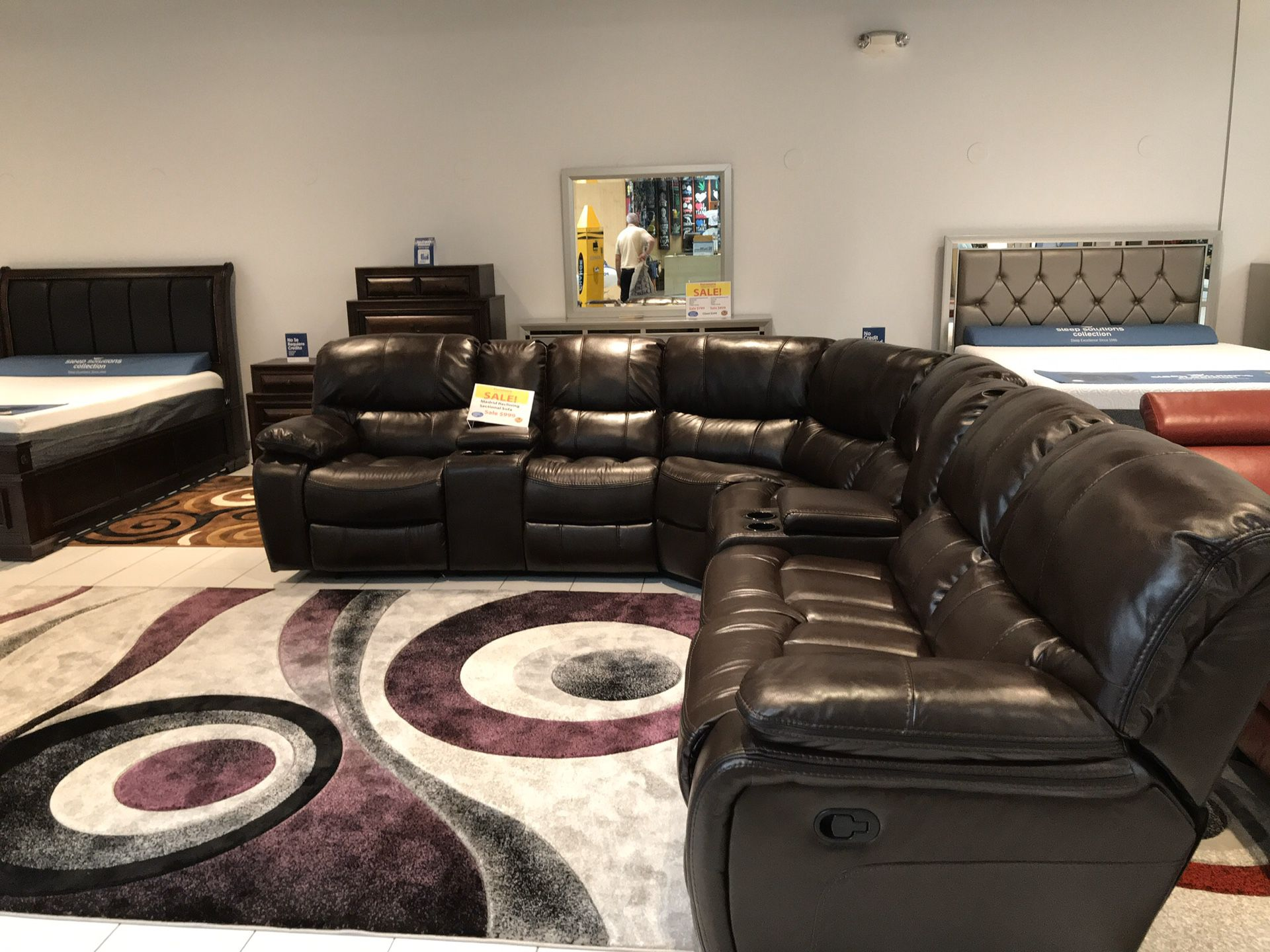 COMFY NEW MADRID MANUAL RECLINING SECTIONAL AVAILABLE IN BROWN$999 AND GRAY$1099. ADD ON NEW DESIGN AREA RUGS $149! DOORBUSTER SALE EVENT! SAME DAY D