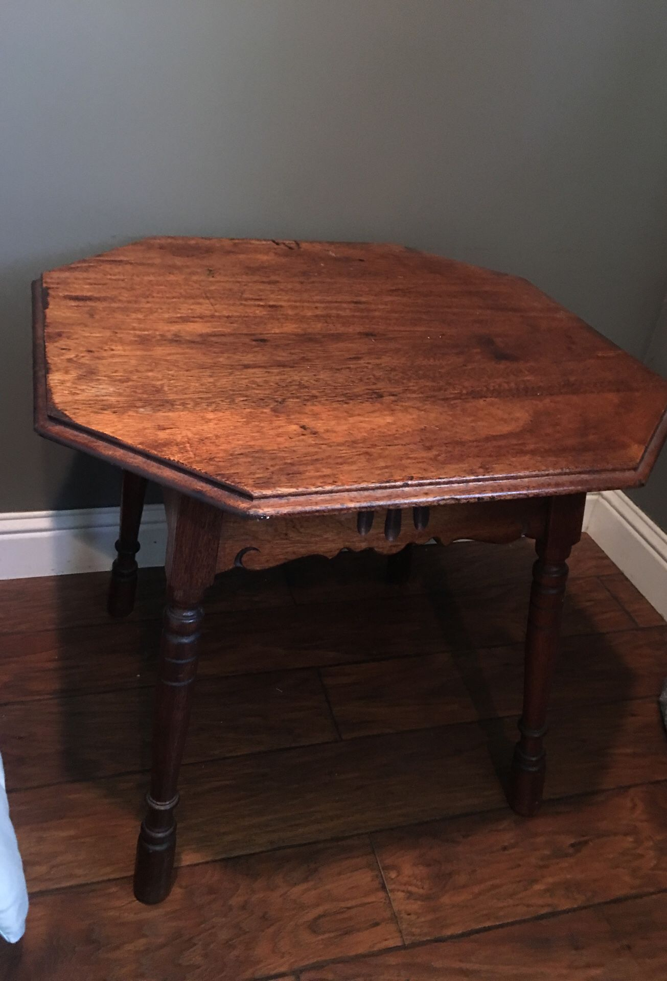 Antique beside table .