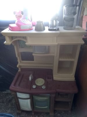 Photo Play kitchen with lots of food and accessories