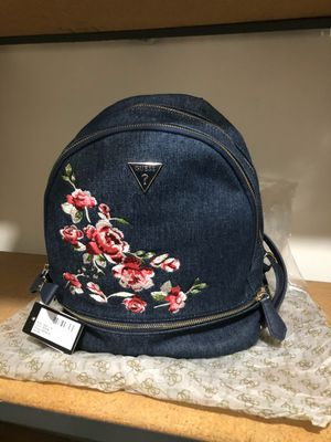 Guess denim backpack with flowers Still in original wrap open box still tags on. for Sale in Los Angeles, CA