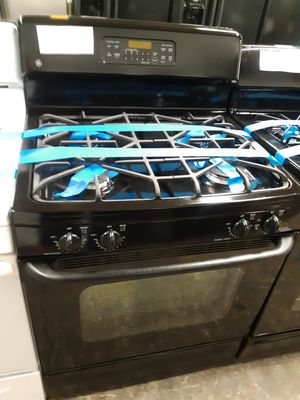 Photo GE BLACK GAS STOVE WORKING PERFECTLY 4 MONTHS WARRANTY