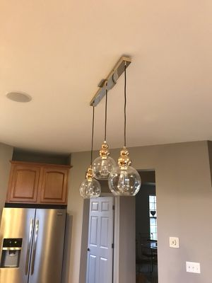 3 pendant lighting fixture, unique, gold and very pretty for Sale in Highland Charter Township, MI