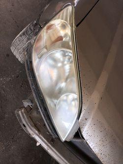 Left and right 04 Honda Civic headlights Thumbnail