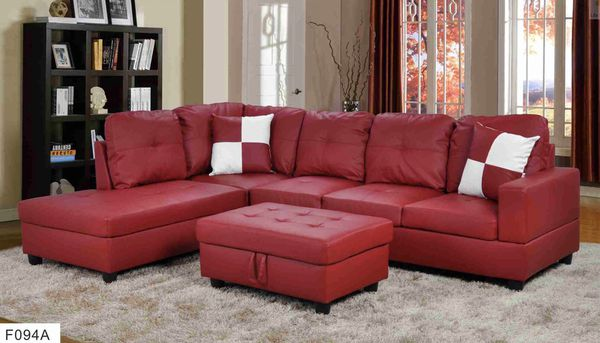 Red faux leather sectional left facing lounge with storage ottoman