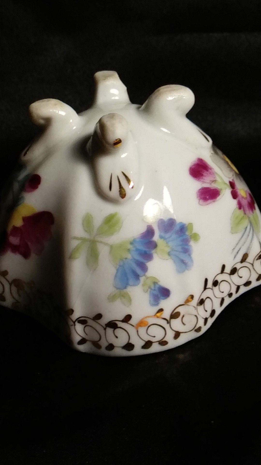 Miniature Porcelain Tea Cup. Four Footed Hand Painted Gold Trim