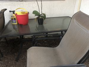 Outside patio table with four chairs for Sale in Huntington Beach, CA