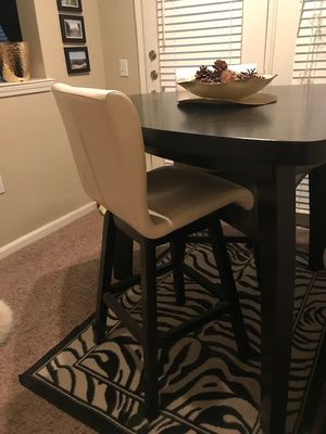 Photo Pub table, two chairs and one bench. Purchased from Rooms To Go in 2015 for $799.00, asking $400.00 or best offer. There are two minor scratches on