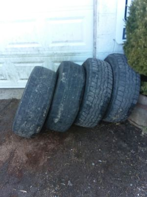 Photo 1998 ford f150 aluminum rims 245/70/16 with NOT so good tires , not selling separate or doing any other measurements they are good rims not bent
