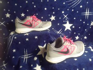 Size 5 youth gray pink and black Nike's for Sale in Cleveland, OH