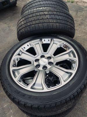 Photo 22 inch oem gm wheels with tires (hablo español)