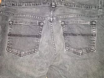 Faded black distressed boot cut jeans size 12R Thumbnail