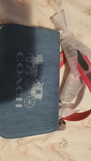 Photo Coach, womens Denim crossbody bag. Medium sized, snap closere