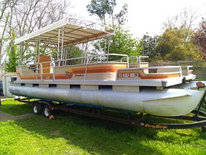 Photo 30 foot party barge tandem axle trailer sun Tracker