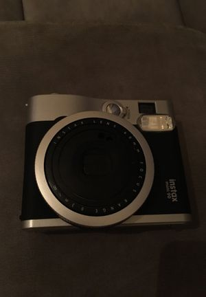 Photo Awesome insta pic camera, just needs battery and film to work! It black and works perfectly the camera works perfectly also