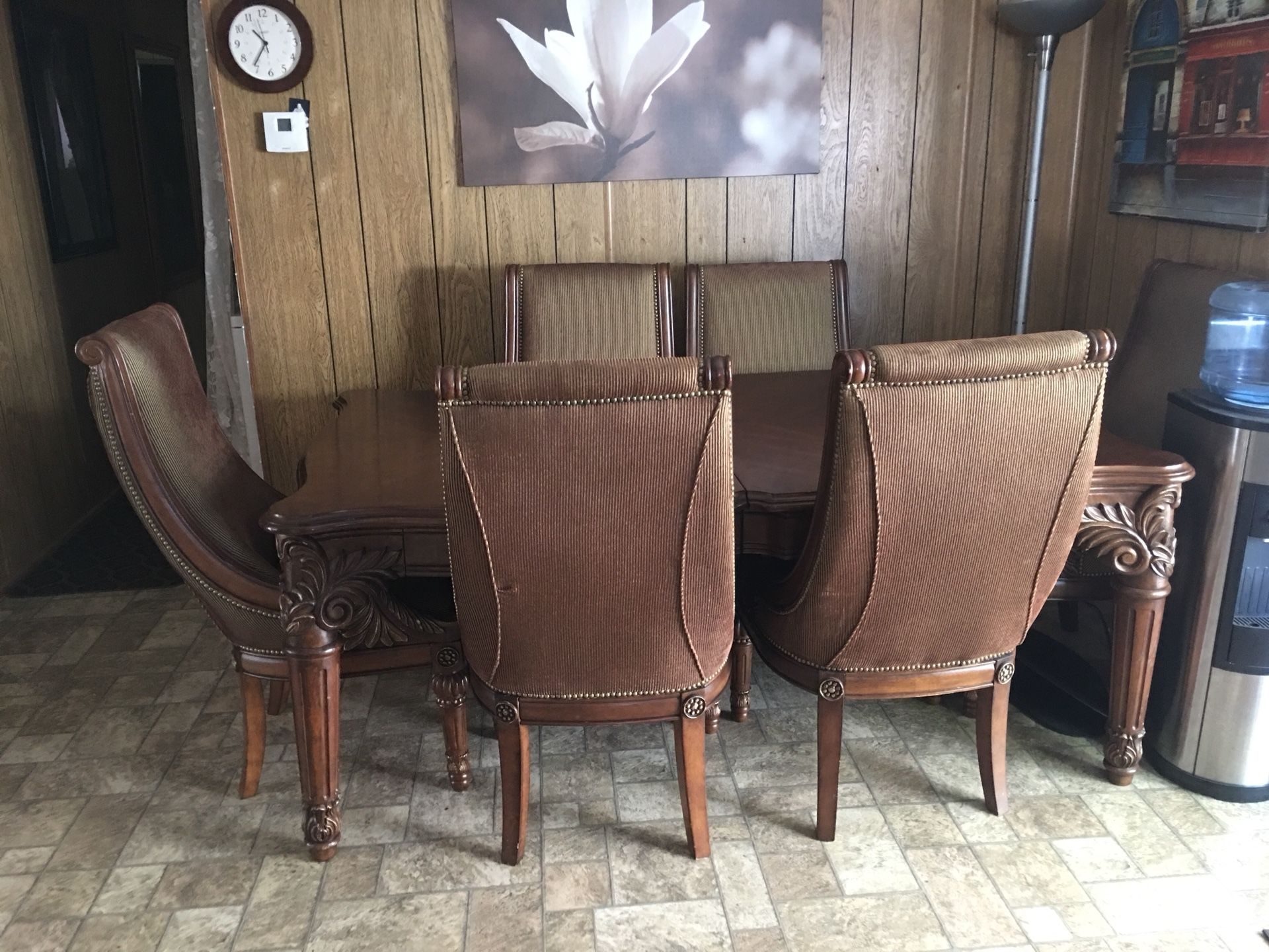 Solid wood dining table with six chairs and two extended if you want to make it bigger