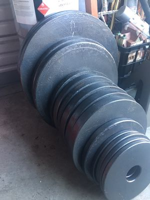 Weights and weight bench And 45 pound bar in Lakewood for Sale in Tacoma, WA