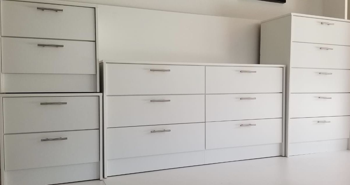 New white dresser chest and two nighstands