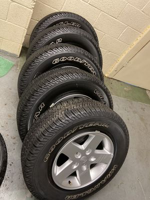 "Photo 5 used 17"" OEM Jeep Wrangler rims with tires 50% tread life"