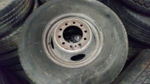 Photo 10 lug 16 inch steel truck rim and tire, great spare. Ford F450