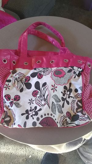 Photo Pink, white, and black purse