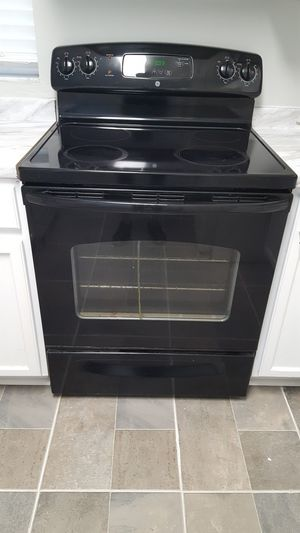 Photo GE black oven glass top