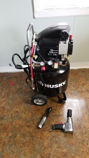 Photo Brand new never use husky air compressor 10gallon 135max psi with air hose ratchet air gun