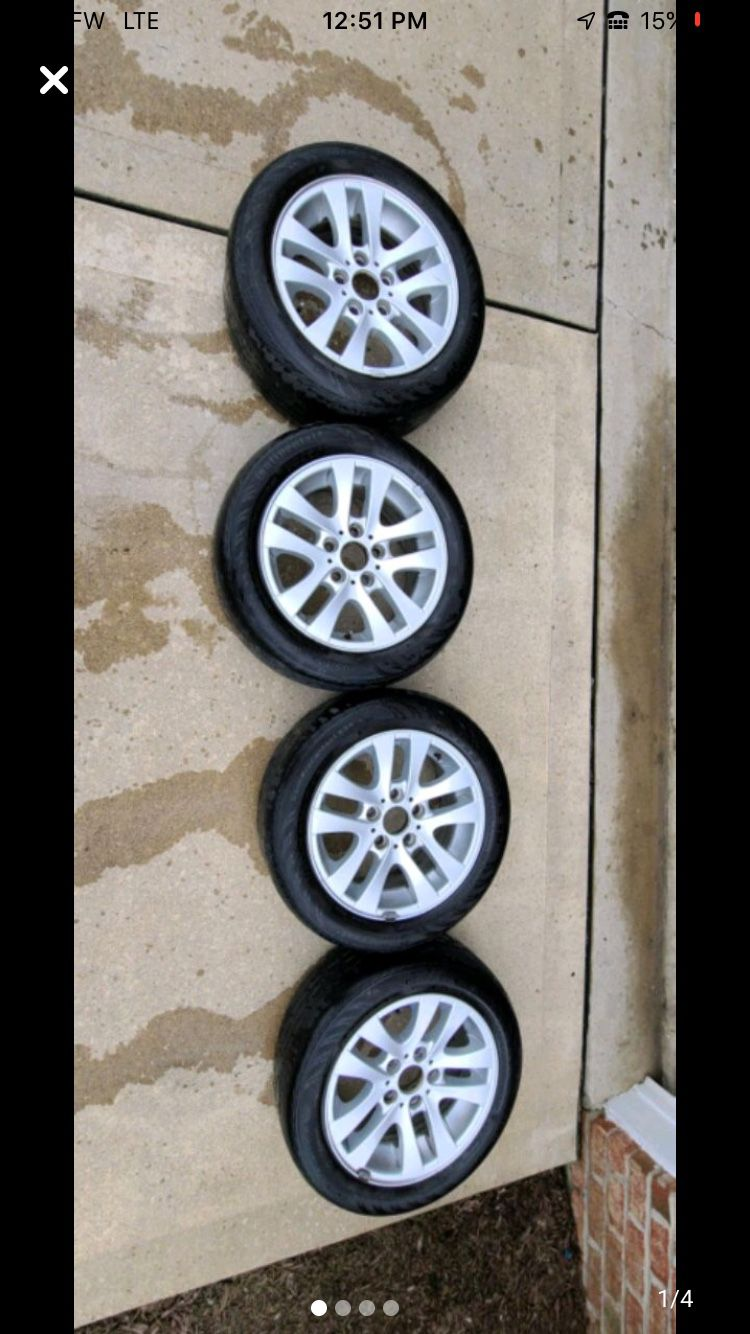 """2007 BMW OEM ALLOYS WHEELS 16"""" with tires at 35% usage."""