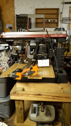 Photo Craftsman heavy duty radial arm saw on rolling table