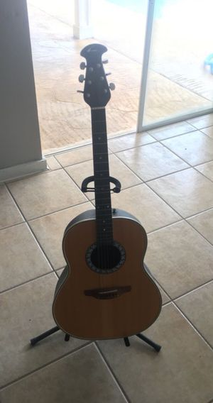 guitar acoustic very nice with stand for Sale in Kissimmee, FL