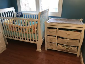 Crib , bedset,changing table with everything including (No clothes) for Sale in Sudley Springs, VA